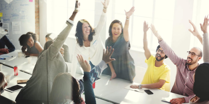 Group of raising hands in a business meeting