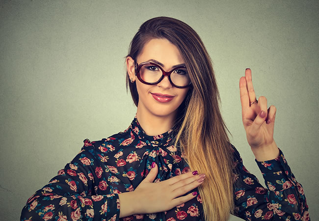 trust-young-woman-pointing-up